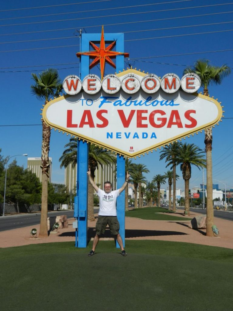 LasVegasNic in the photo with the famous welcome to fabulous lasvegas nevada sign